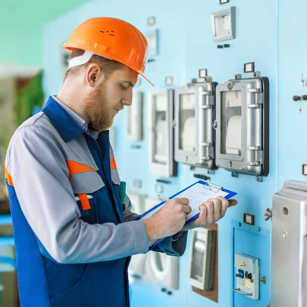 industrial worker filling out quality assurance checklist